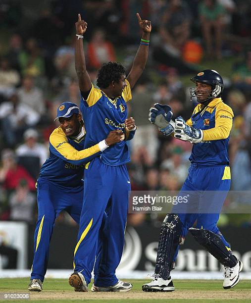 Ajantha Mendis of Sri Lanka celebrates with team mates Thilan Samaraweera and Kumar Sangakkara after taking the wicket of JP Duminy of South Africa...