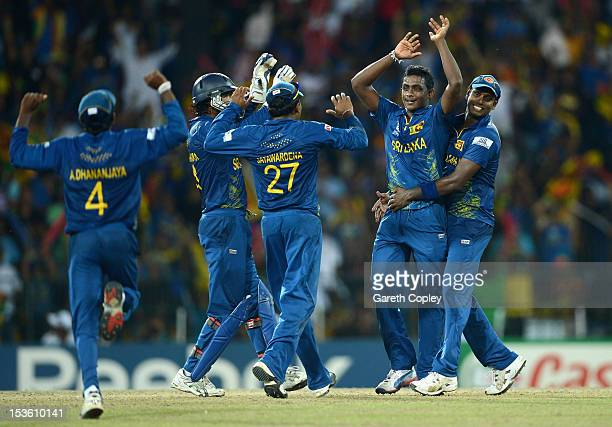 Ajantha Mendis of Sri Lanka celebrates with teammates after dismissing Andre Russell of the West Indies during the ICC World Twenty20 2012 Final...