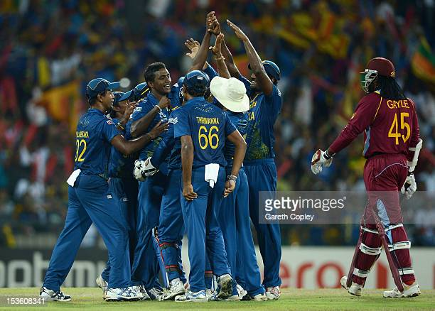 Ajantha Mendis of Sri Lanka celebrates with teammates after dismissing Chris Gayle of the West Indies during the ICC World Twenty20 2012 Final...