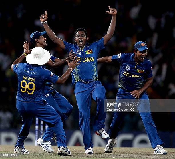 Ajantha Mendis of Sri Lanka celebrates with teammates after trapping Chris Gayle of West Indies LBW during the ICC World Twenty20 2012 Final between...