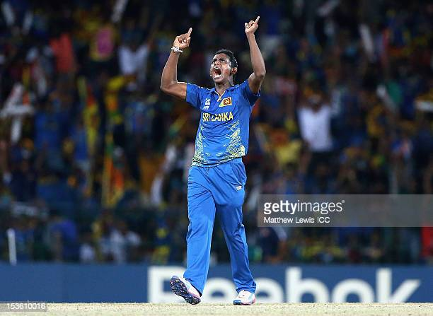 Ajantha Mendis of Sri Lanka celebratesbowling Dwayne Bravo of the West Indies for LBW during the ICC World Twenty20 2012 Final between Sri Lanka and...