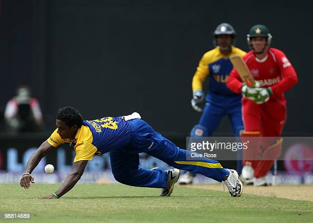 Ajantha Mendis of Sri Lanka dives to make a stop off his own bowling during the ICC T20 World Cup Group B match between Sri Lanka and Zimbabwe at the...