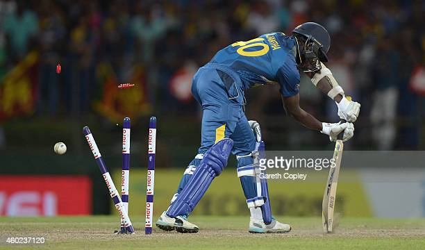 Ajantha Mendis of Sri Lanka is bowled by Chris Woakes of England during the 5th One Day International between Sri Lanka and England at Pallekele...