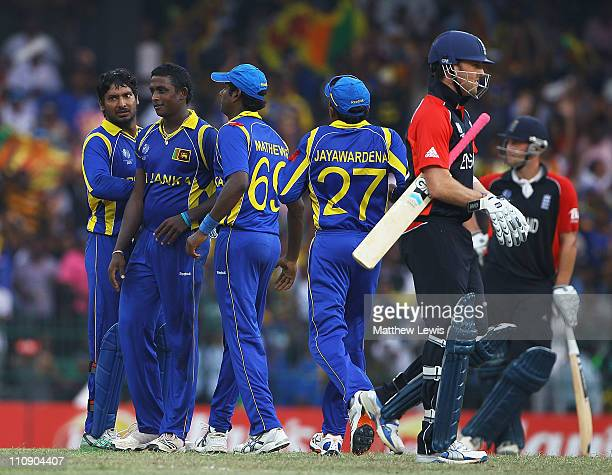 Ajantha Mendis of Sri Lanka is congratulated after bowling Graeme Swann of England for LBW during the 2011 ICC World Cup Quarter Final match between...