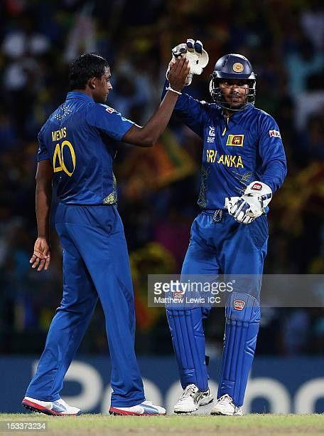 Ajantha Mendis of Sri Lanka is congratulated by Kumar Sangakkara after Sohail Tanvir of Pakistan was stumped during the ICC World Twenty20 2012 Semi...