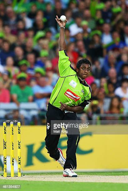 Ajantha Mendis of the Thunder bowls during the Big Bash League match between Sydney Thunder and Brisbane Heat at ANZ Stadium on January 8 2014 in...