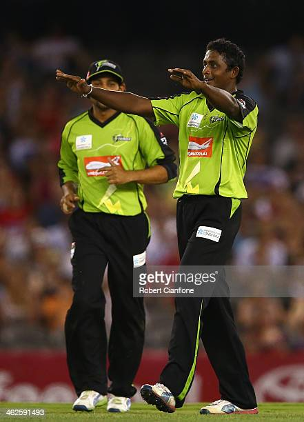 Ajantha Mendis of the Thunder celebrates the wicket of James Pattinson of the Renegades during the Big Bash League match between the Melbourne...