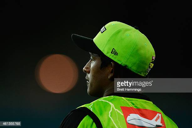Ajantha Mendis of the Thunder looks on during the Big Bash League match between Sydney Thunder and Brisbane Heat at ANZ Stadium on January 8 2014 in...
