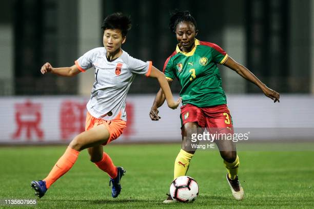 Ajara Nchout Njoya Cameroon and Lou Jiahui China in action during Wuhan International Women's Football Championship between China v Cameroon at...