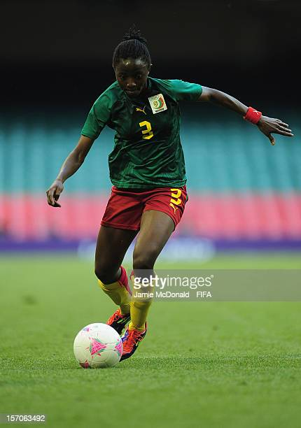 Ajara Nchout of Cameroon in action during Group E Woman's Football match between Cameroon and Brazil at Millennium Stadium on July 25 2012 in Cardiff...
