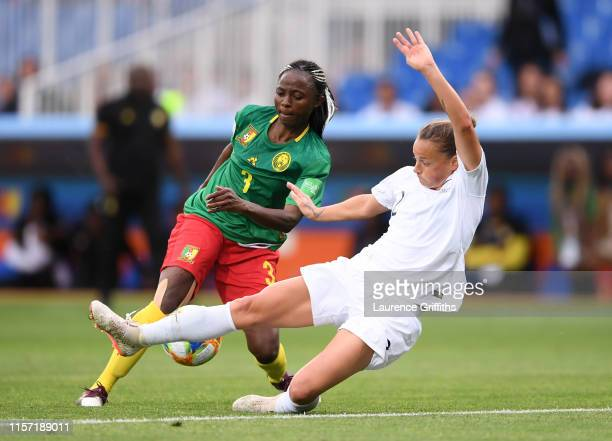 Ajara Nchout of Cameroon runs with the ball past Ria Percival of New Zealand to score her team's second goal during the 2019 FIFA Women's World Cup...
