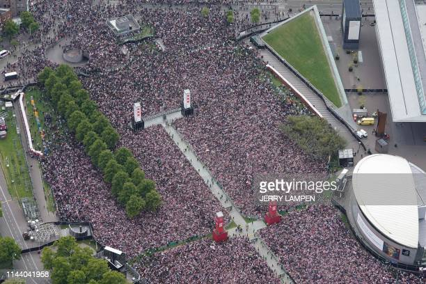 Ajax Amsterdam football supporters gather on the Museumplein in Amsterdam to celebrate with players the club's 34th national champion title after...