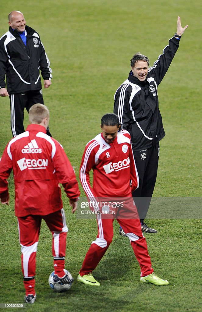 -- Ajax Amsterdam head coach Marco van Basten (R) gives instructions during a training session on March 11, 2009 at the Velodrome Stadium on the eve of the UEFA Cup round of 16 first leg match Marseille vs. Ajax Amsterdam.