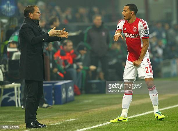 Ajax Amsterdam manager Frank De Boer issues instructions to his player Ricardo van Rhijn during the UEFA Champions League Group H match between AC...