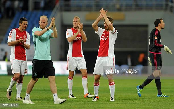 Ajax Amsterdam players acknowledge the crowd after a friendly match against Chinese Super League club Liaoning Whowin FC in Shenyang northeast...