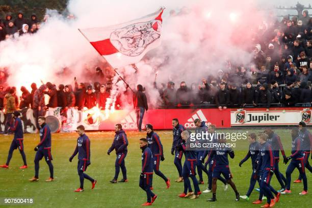 Ajax Amsterdam players walk during the public training in Amsterdam on January 20 in the runup to the match against Feyenoord tomorrow / AFP PHOTO /...