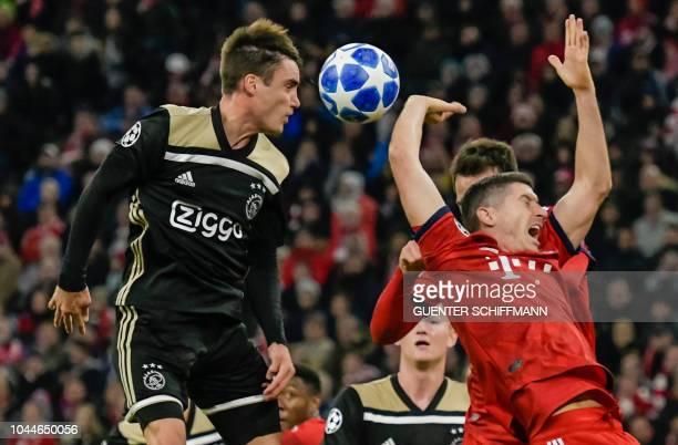 Ajax Amsterdam's Argentian defender Nicolas Tagliafico and Bayern Munich's Polish forward Robert Lewandowski vie for the ball during the UEFA...