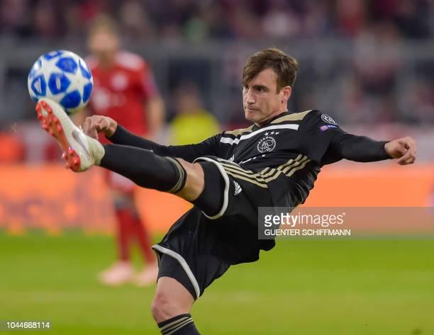 Ajax Amsterdam's Argentian defender Nicolas Tagliafico kicks the ball during the UEFA Champions League Group E football match between Bayern Munich...
