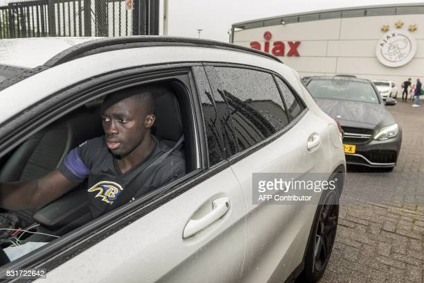 Ajax Amsterdam's Colombian footballer Davinson Sanchez drives a vehicle as he leaves the team training complex at De Toekomst in Amsterdam on August...