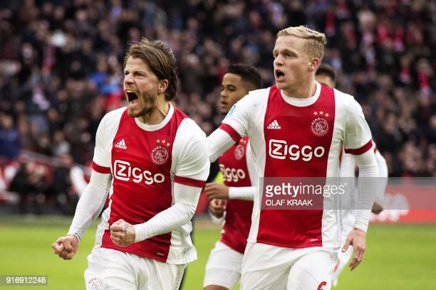 Ajax Amsterdam's Danish midfielder Lasse Schone reacts with temmate midfielder Donny van de Beek after scoring his team's second goal during the...