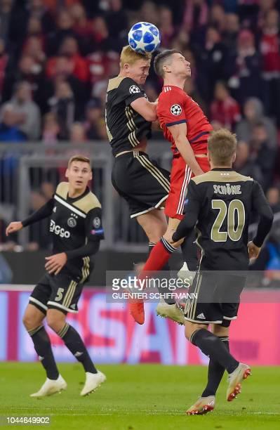 Ajax Amsterdam's Dutch defender Matthijs de Ligt and Bayern Munich's Polish forward Robert Lewandowski vie for the ball during the UEFA Champions...