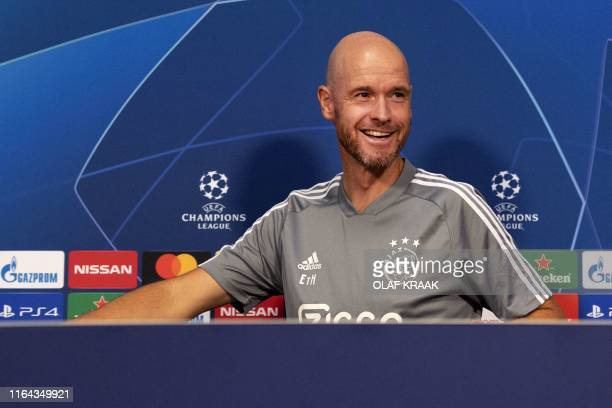Ajax Amsterdam's Dutch head coach Erik ten Hag smiles during a press conference in Amsterdam The Netherlands on August 27 on the eve of their UEFA...