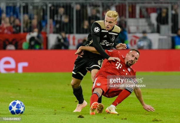 Ajax Amsterdam's Dutch midfielder Donny van de Beek and Bayern Munich's French midfielder Franck Ribery vie for the ball during the UEFA Champions...