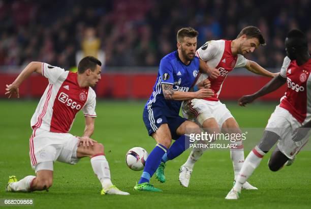 Ajax Amsterdam's dutch midfielder Nick Viergever Schalke's Austrian striker Guido Burgstaller and Ajax Amsterdam's Dutch defender Joel Veltmann vie...