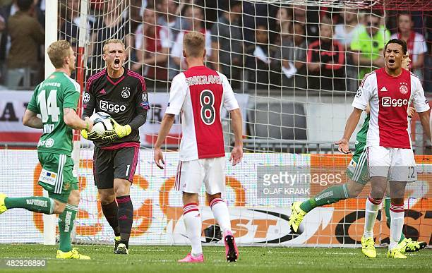 Ajax Amsterdam's goalkeeper Jasper Cillessen reacts after conceding a goal during the UEFA Champions League third qualifying round football match...
