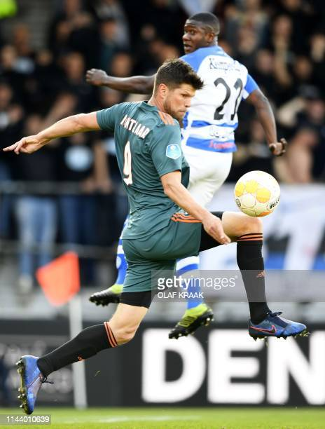 Ajax Amsterdam's KlaasJan Huntelaar controls the ball in front of De Graafschap Doetinchem's Azor Matusiwa during the Dutch Eredivisie football match...