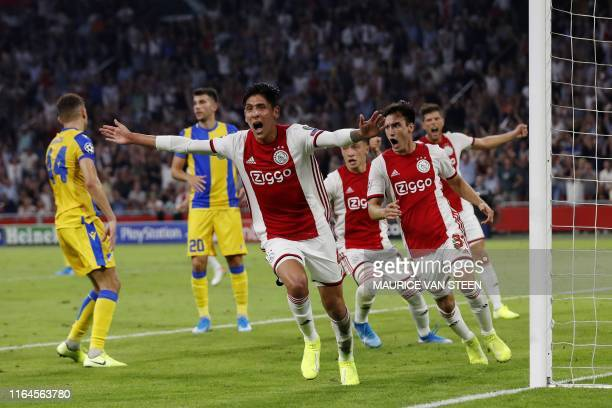 Ajax Amsterdam's Mexican forward Edson Alvarez celebrates after scoring during the UEFA Champions League Group phase football match between Ajax...
