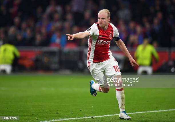 Ajax Amsterdam's midfielder Davy Klaassen celebrates after scoring during the UEFA Europa League football match between Ajax Amsterdam and Schalke 04...