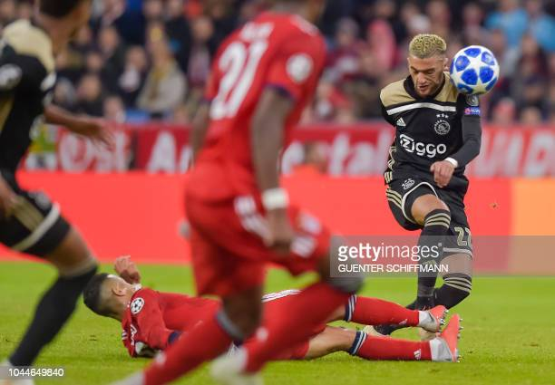 Ajax Amsterdam's Moroccan midfielder Hakim Ziyech vies for the ball during the UEFA Champions League Group E football match between Bayern Munich and...