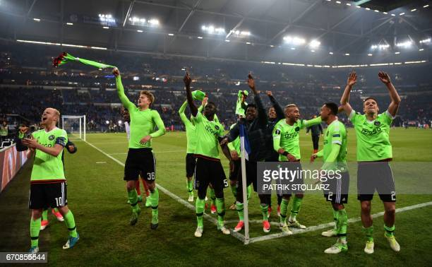Ajax Amsterdam's players celebrate after the UEFA Europa League 2ndleg quarterfinal football match between Schalke 04 and Ajax Amsterdam in...