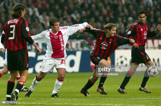 Ajax Amsterdam's Rafael van der Vaart duels with Massimo Ambrossini of AC Milan during their Champions League quarter final first round match in...