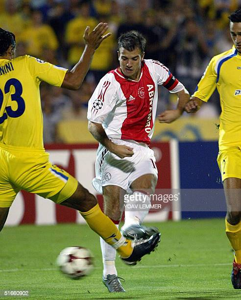 Ajax Amsterdam's Rafael Van Der Vaart makes his way towards Maccabi Tel Aviv's side during their Champions league match at the Ranat Gan stadium...