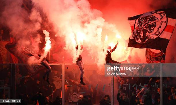 TOPSHOT Ajax Amsterdam's supporters celebrate at the end of the Dutch Eredivisie football match between De Graafschap Doetinchem and Ajax Amsterdam...