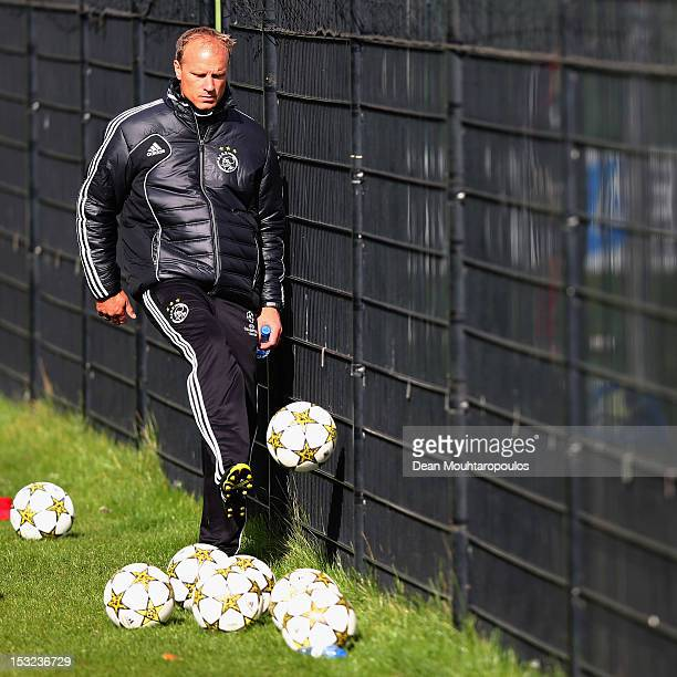 Ajax Assistant Manager Dennis Bergkamp kicks a ball during the Ajax Amsterdam training session at De Toekomst training ground on October 2 2012 in...