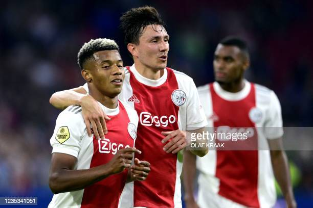 Ajax' Brazilian forward David Neres and Dutch forward Steven Berghuis celebrate their fourth goal during the Dutch Eredivisie football match between...
