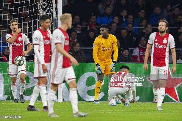 Ajax' Cameroonian goalkeeper Andre Onana and teammates react after valencia scored the opener during the UEFA Champions League group H football match...