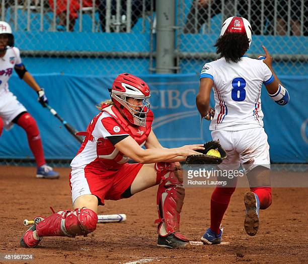 Ajax Canada July 25 2015 Canada's catcher Kaleigh Rafter can't quite catch up with Puerto Rico's Aleshia Ocasio to apply the tag in the 4th inning...