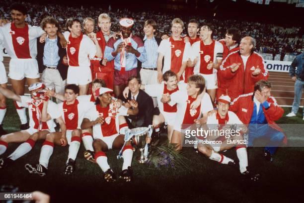 Ajax celebrate with the trophy after their 10 victory Frank Rijkaard Danny Blind Arnold Muhren Erik de Haan Stanley Menzo John Bosman Dennis Bergkamp...