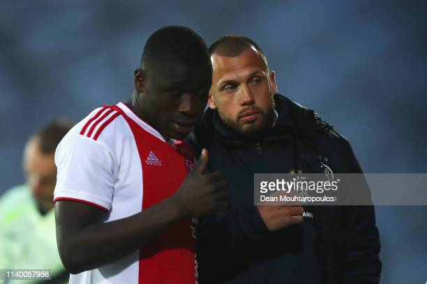 Ajax Coach John Heitinga speaks to Brian Brobbey during the YOUTH CUP U19 between Ajax U19 and Excelsior U19 at Sportpark De Toekomst Johan Cruyff...