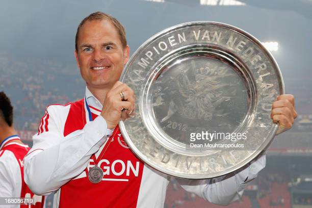 Ajax Coach / Manager Frank de Boer poses with the Eredivisie Championship trophy after the match between Ajax and Willem II Tilburg at Amsterdam...