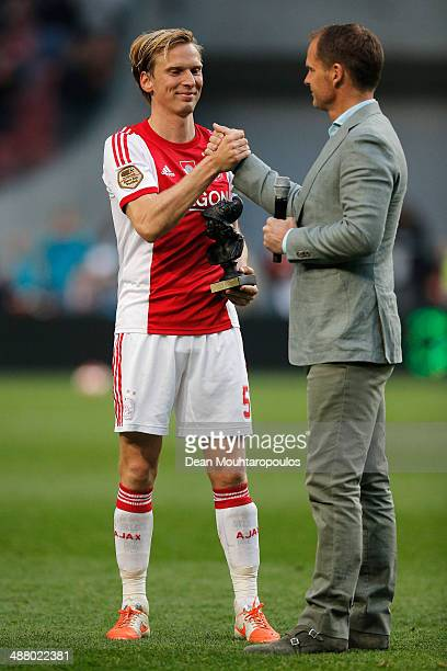 Ajax Coach / Manager Frank de Boer thanks Christian Poulsen of Ajax after he plays his last game after the Eredivisie match between Ajax Amsterdam...