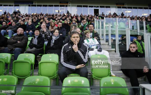 Ajax coach Marco van Basten sits in the stands after being sent off the pitch by the referee during a league match against Groningen on January 25...