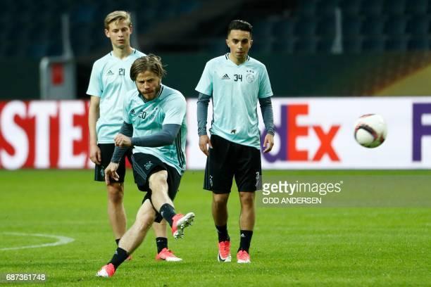Ajax Danish Midfielder Lasse Schone shoots the ball as his teammates Ajax Dutch midfielder Frenkie de Jong and Ajax Dutch midfielder Abdelhak Nouri...
