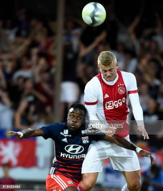 Ajax defender Matthijs de Ligt and Lyon's French forward Maxwel Cornet go for a header during a friendly football match between Olympique Lyonnais...