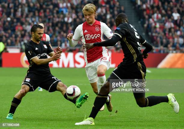 Ajax defender Matthijs de Ligt vies with Lyon's defender Mouctar Diakhaby and Lyon's French defender Jeremy Morel during UEFA Europa League semifinal...