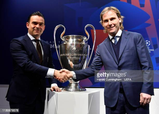 Ajax Director of Football Marc Overmars and Juventus VicePresident Pavel Nedved with the trophy following the UEFA Champions League 2018/19...